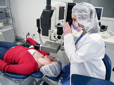 Doctor examining a woman's eyes