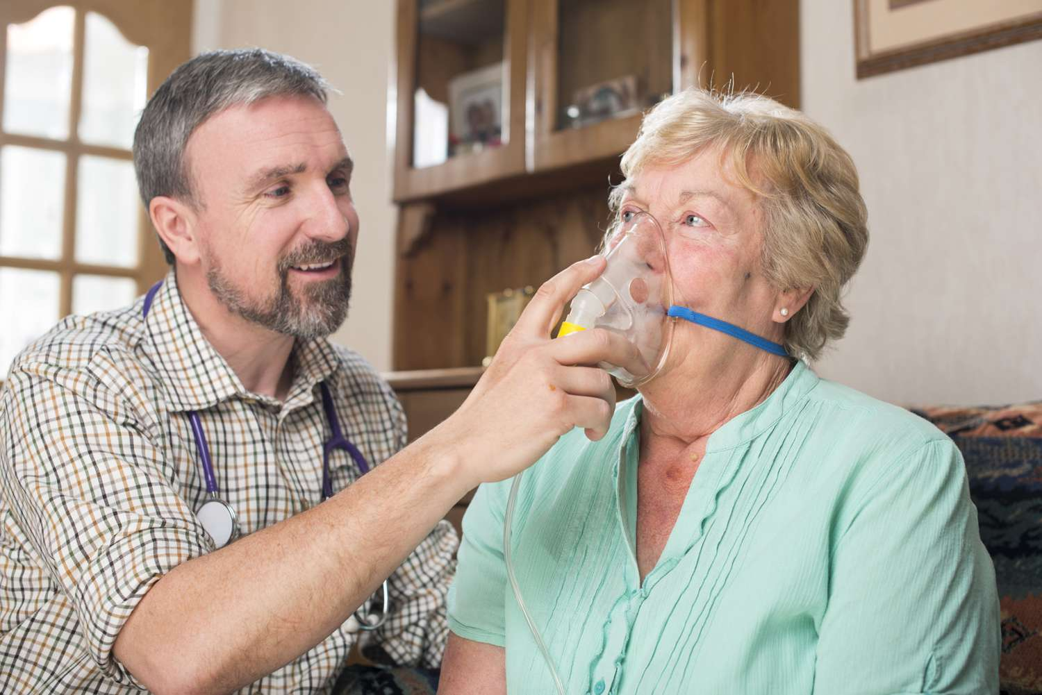 Health professional administering oxygen