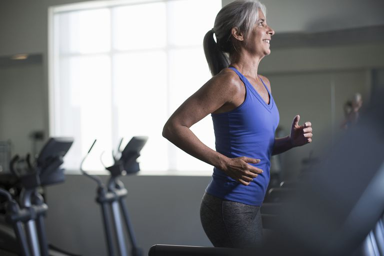 mature woman running on treadmill