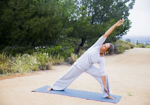 A woman doing yoga outside