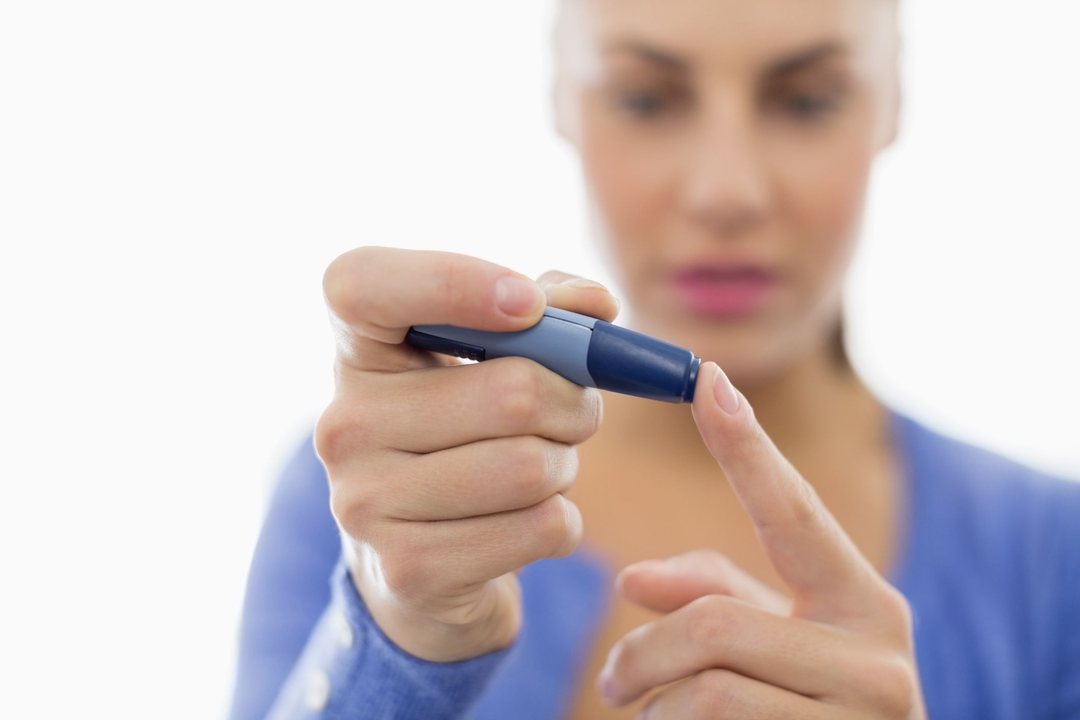 Woman with diabetes testing device