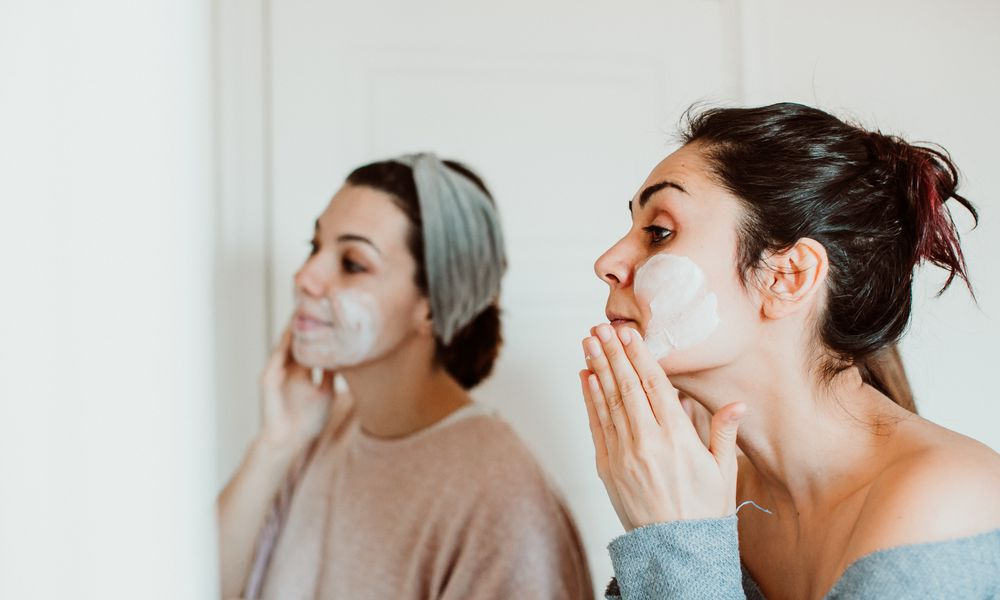 Women Applying Facial Mask