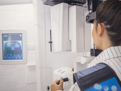 Woman being scanned for oral problems