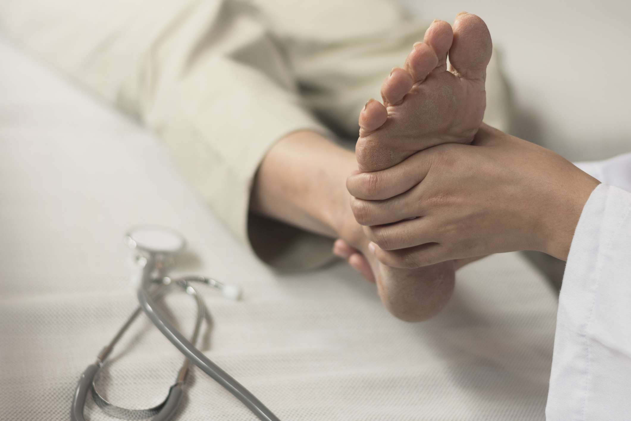 foot being examined at the doctor