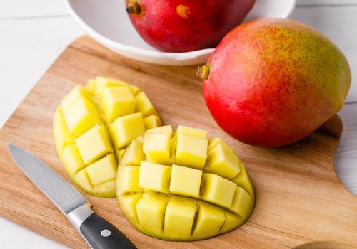 Mango on cutting board