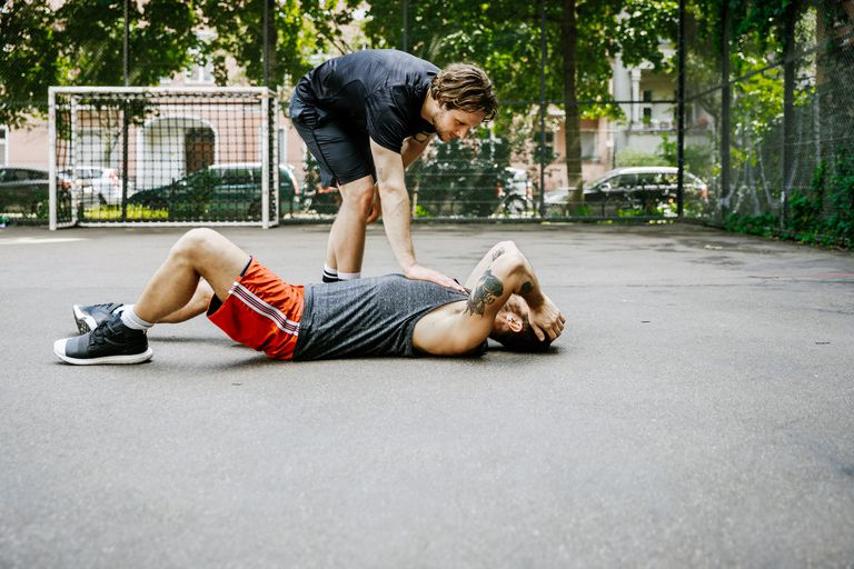 Man lying down on soccer court