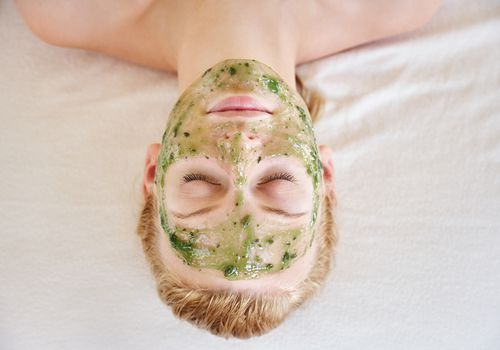 Woman with aloe face mask