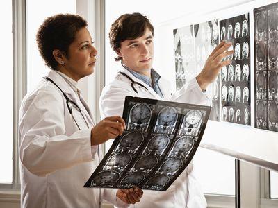 doctors examining MRI results