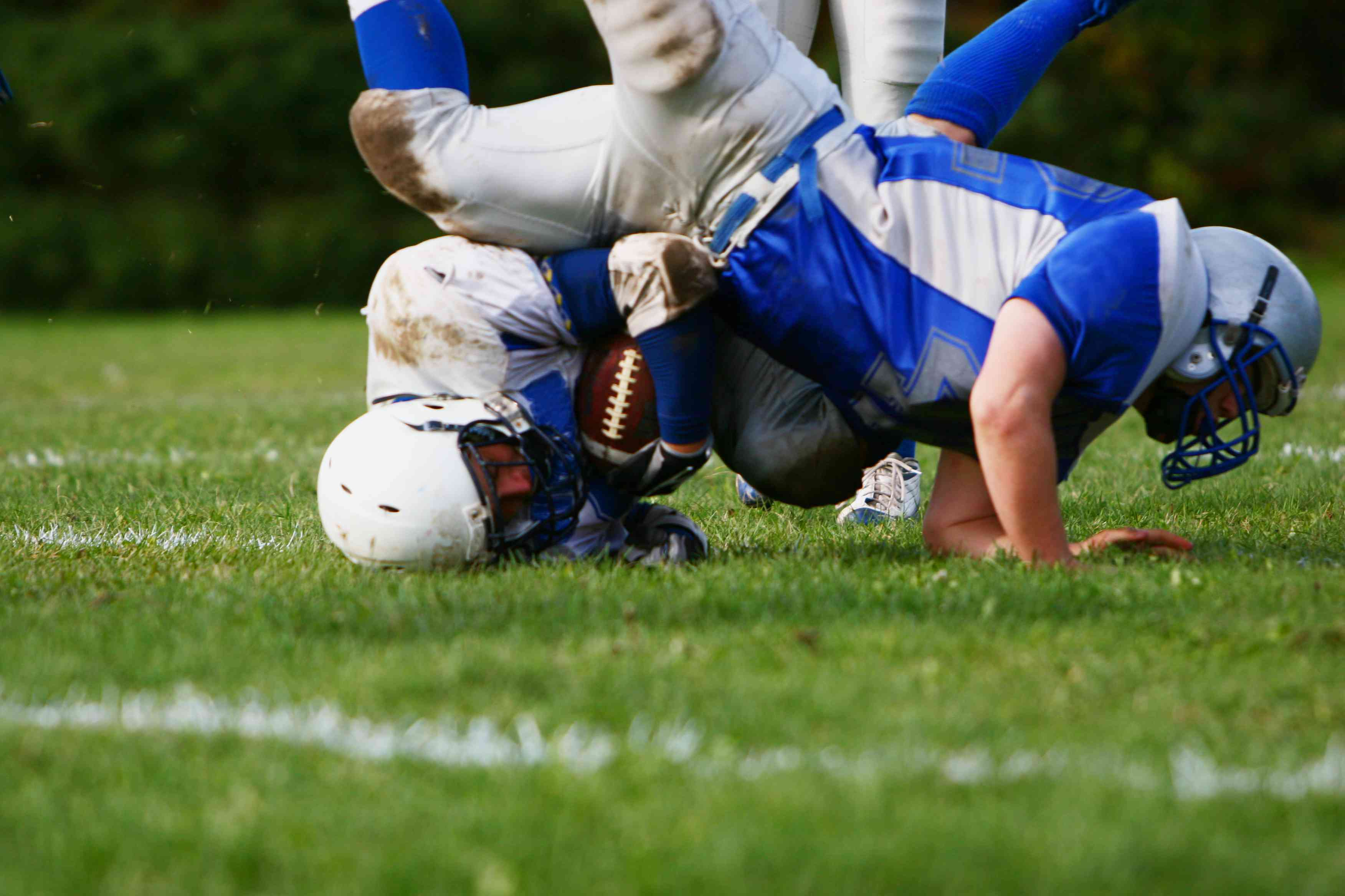 American football players colliding on the field
