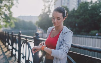Woman checking heart rate after sports