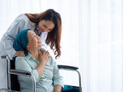 Doctor encouraging older female patient