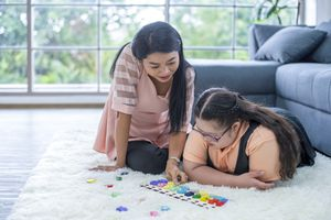 Portrait of a mother with daughter Autism and Down Syndrome in daily lives