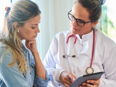 Doctor consulting with her patient