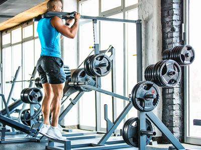 Photo of a man performing calf raises in a gym.