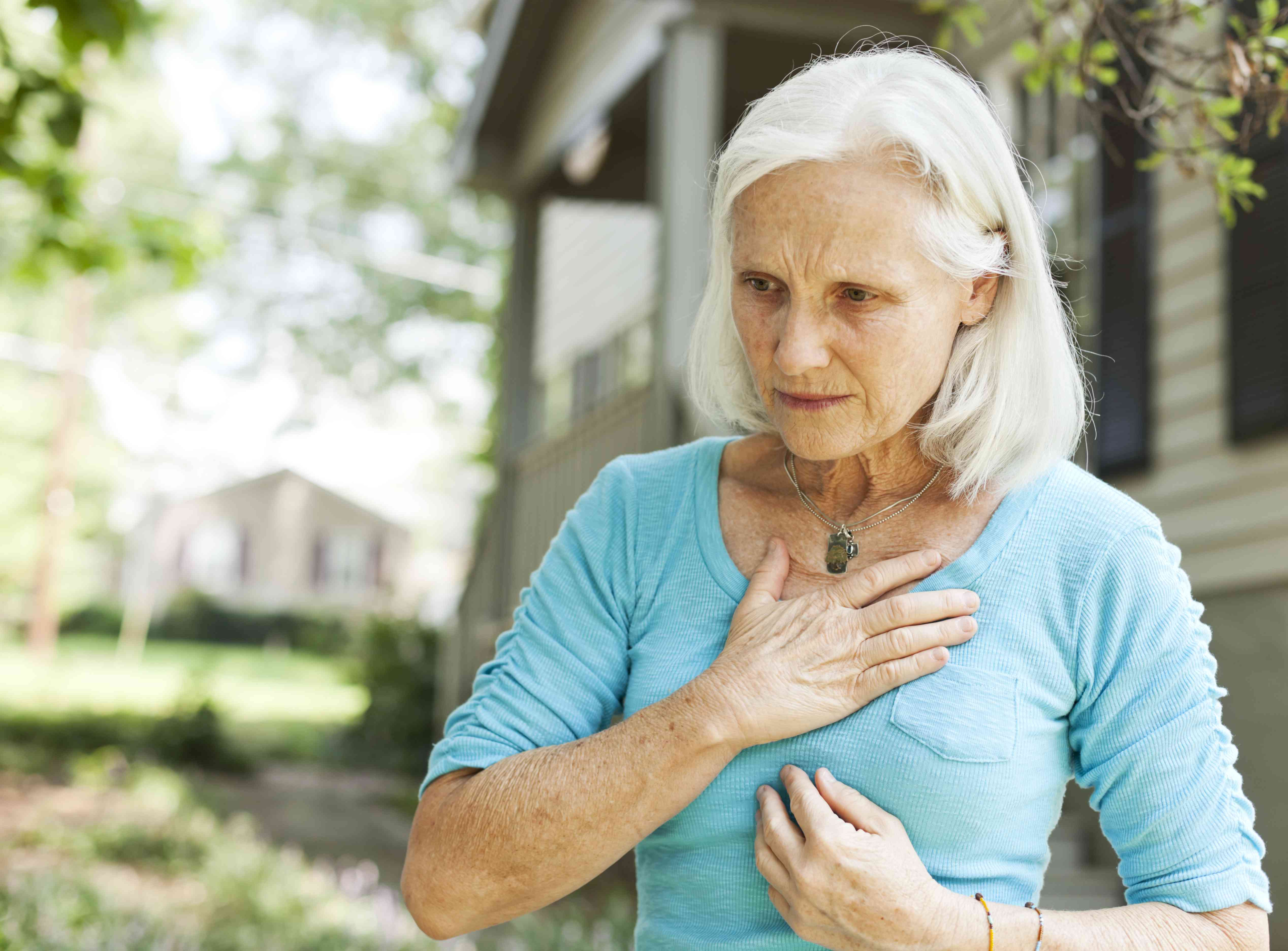 Senior with hands on chest
