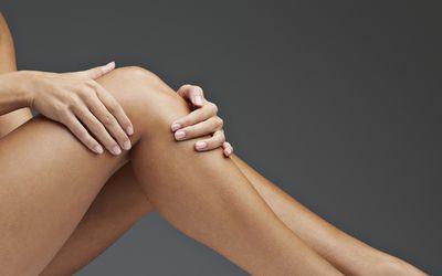 Close up of woman having knee pain