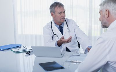 male doctor and patient talking