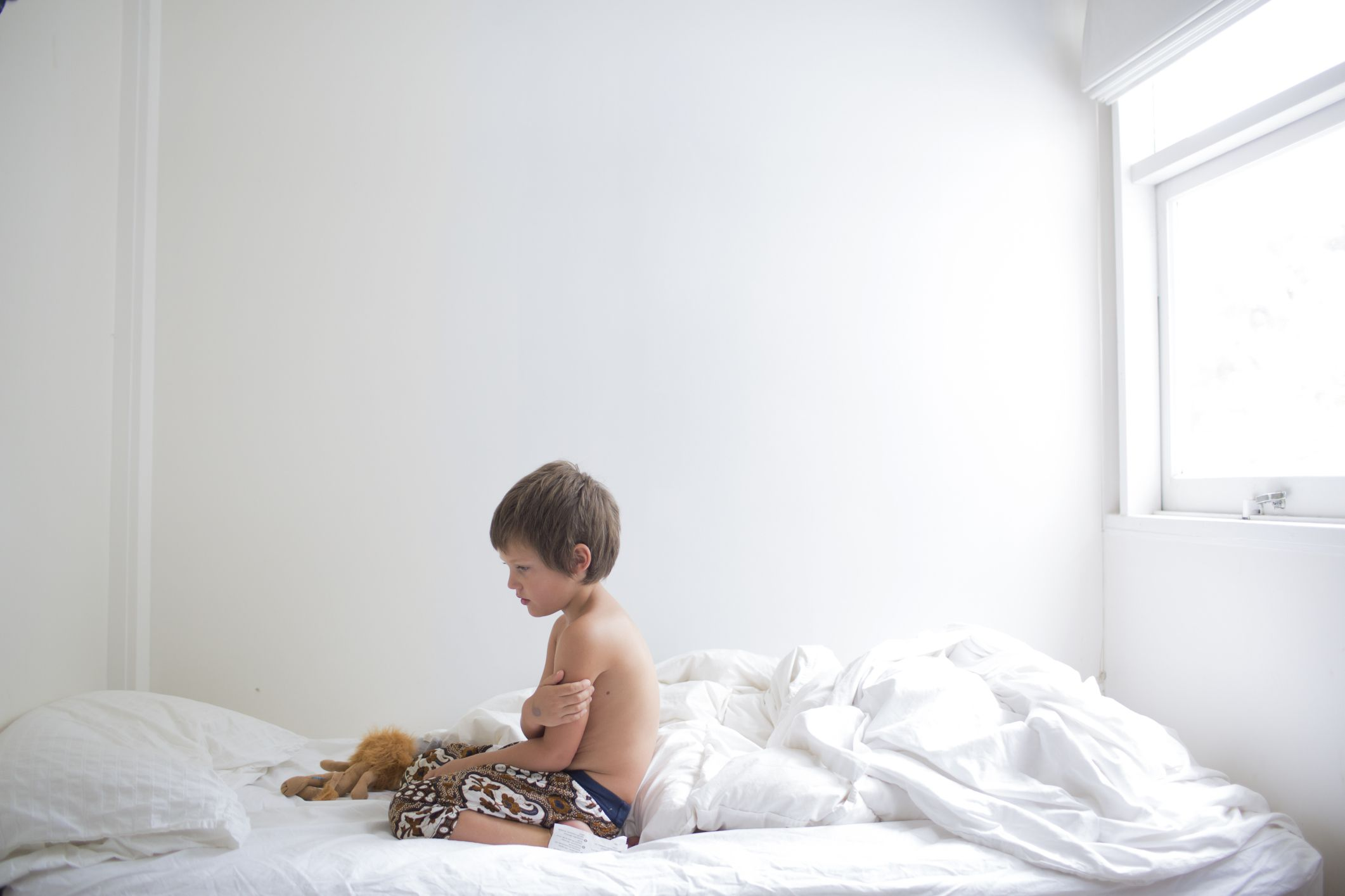 Child sitting up in bed