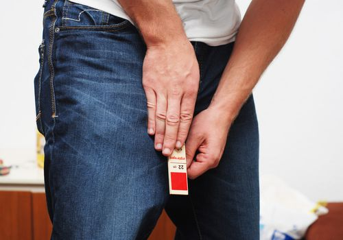 A man attempting to measure his penis