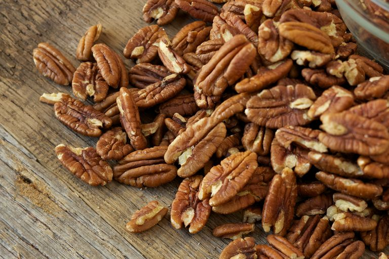 Pecans on rustic wood table