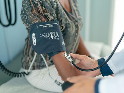 woman getting her blood pressure taken
