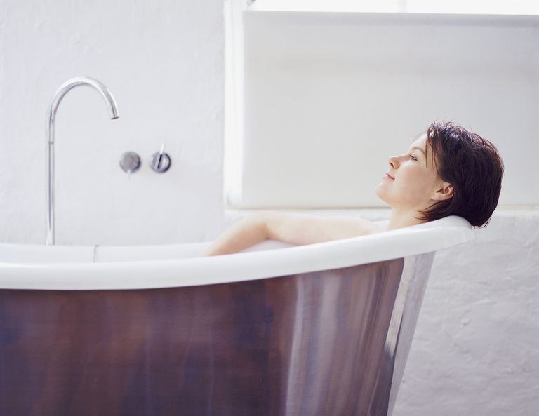 Woman relaxing in a bathtub