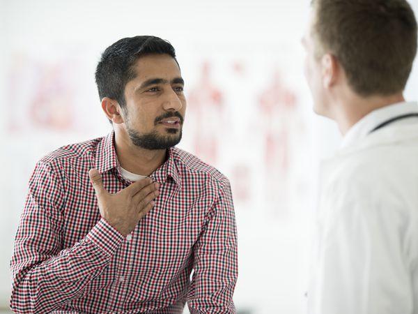 Doctor Checking a Man Cough