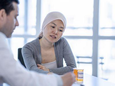 Cancer Patient Reviewing Prescriptions stock photo