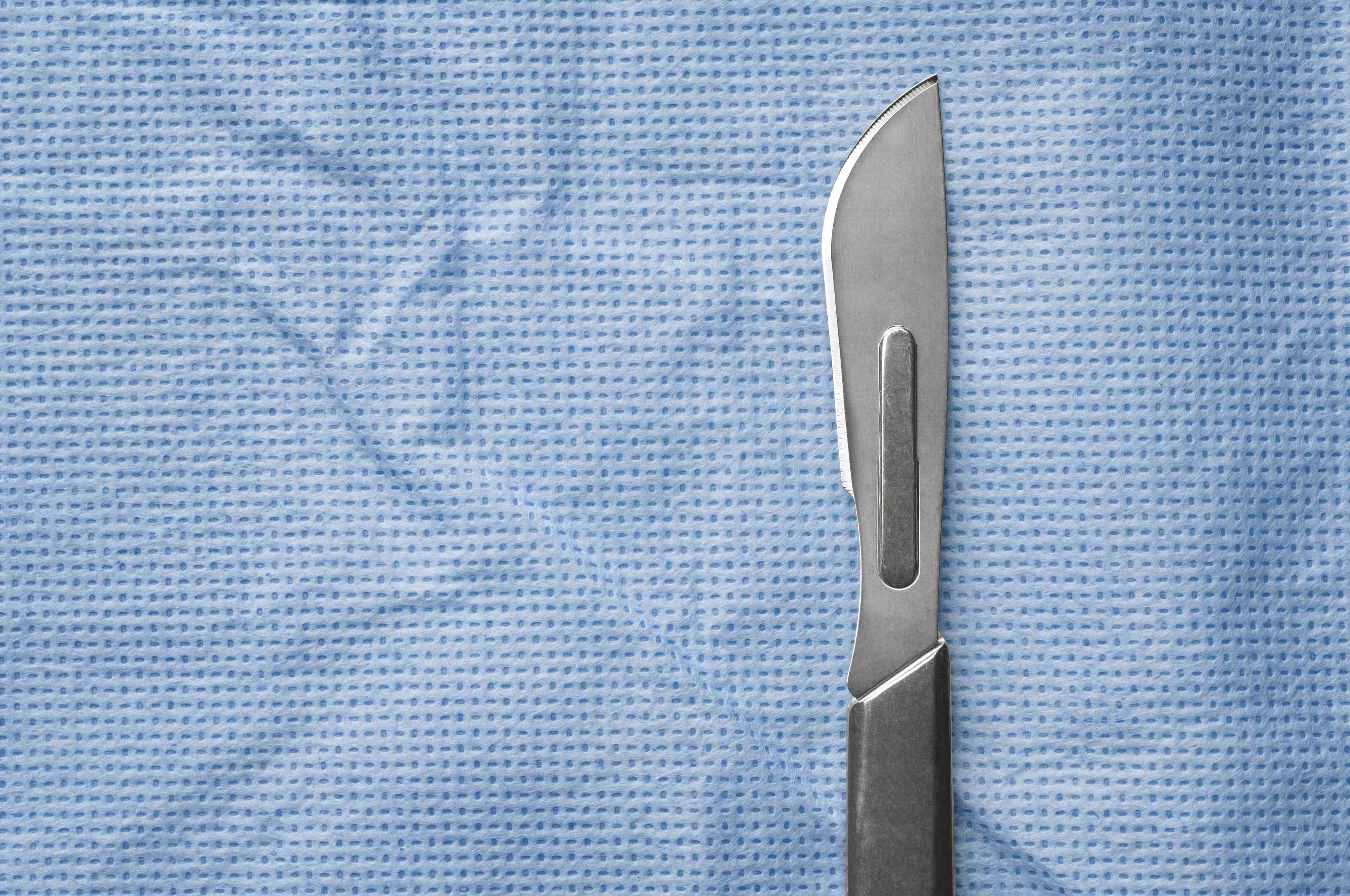 A scalpel on surgical cloth