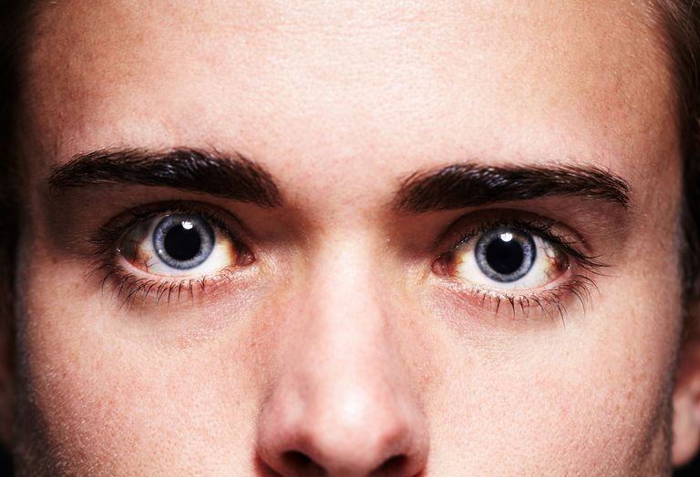 ee728a714b3 High as a kite Closeup portrait of a young man s face with dilated pupils