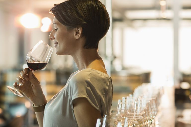 Woman wine tasting red wine should worry about risk of breast cancer