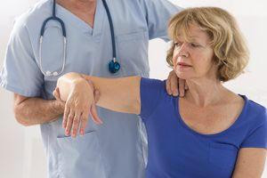 Doctor examining a patients shoulder