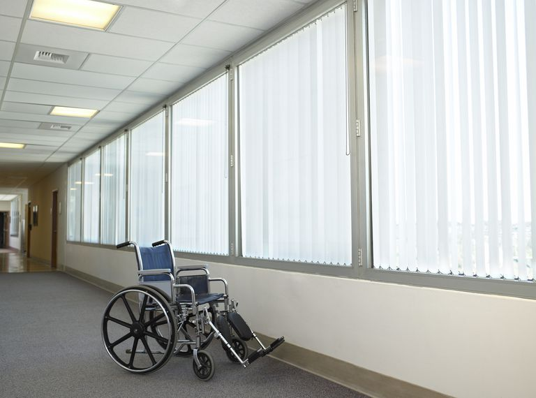 Wheelchair in hospital corridor