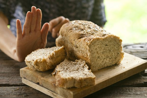 Hand refusing bread