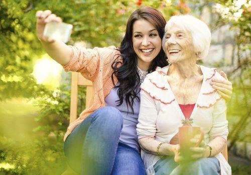 Woman taking a selfie with an elderly woman