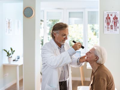 Doctor looking at patient's eye