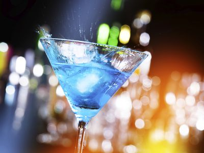blue cocktail in a martini glass