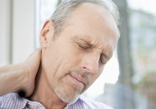 Senior man with neck pain.