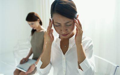 Woman feeling dizzy in waiting room