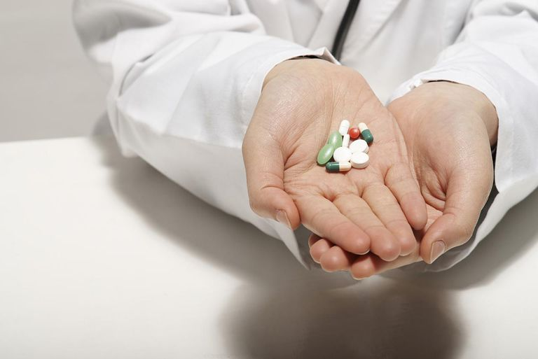 doctor with handful of pills