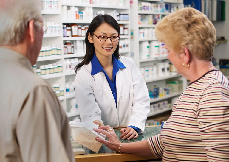 Pharmacy Counter Pharmacist helping customers