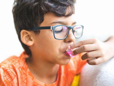 Child taking cough medicine