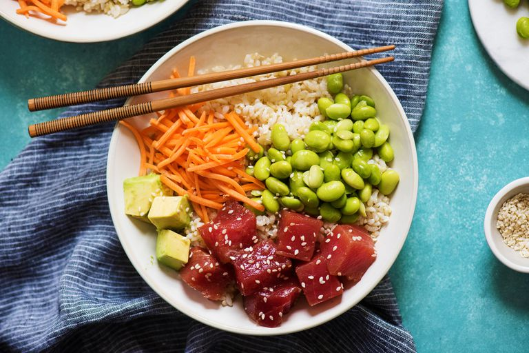 Poke bowl of rice and vegetables on a table