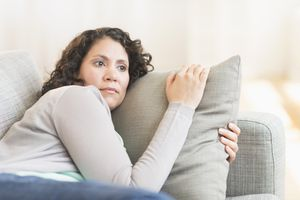 middle aged woman staring on the couch
