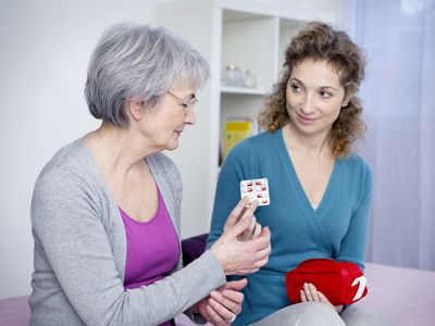 Social aid for elderly person Senior woman with her carer.
