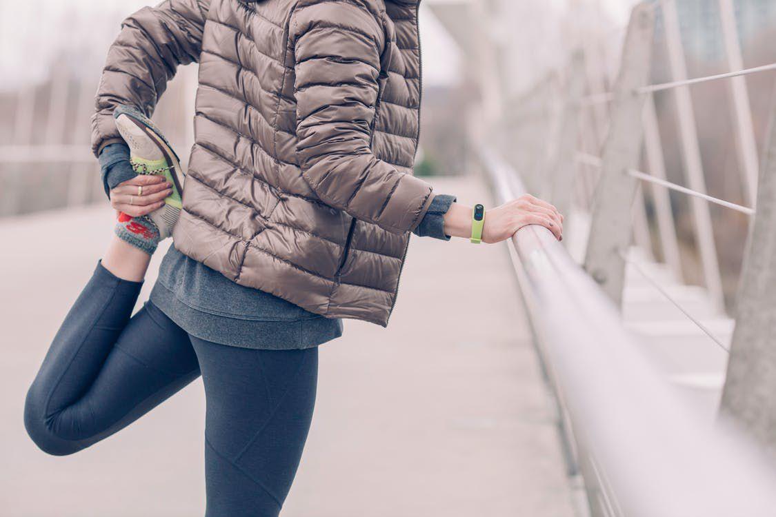 woman stretching before jog
