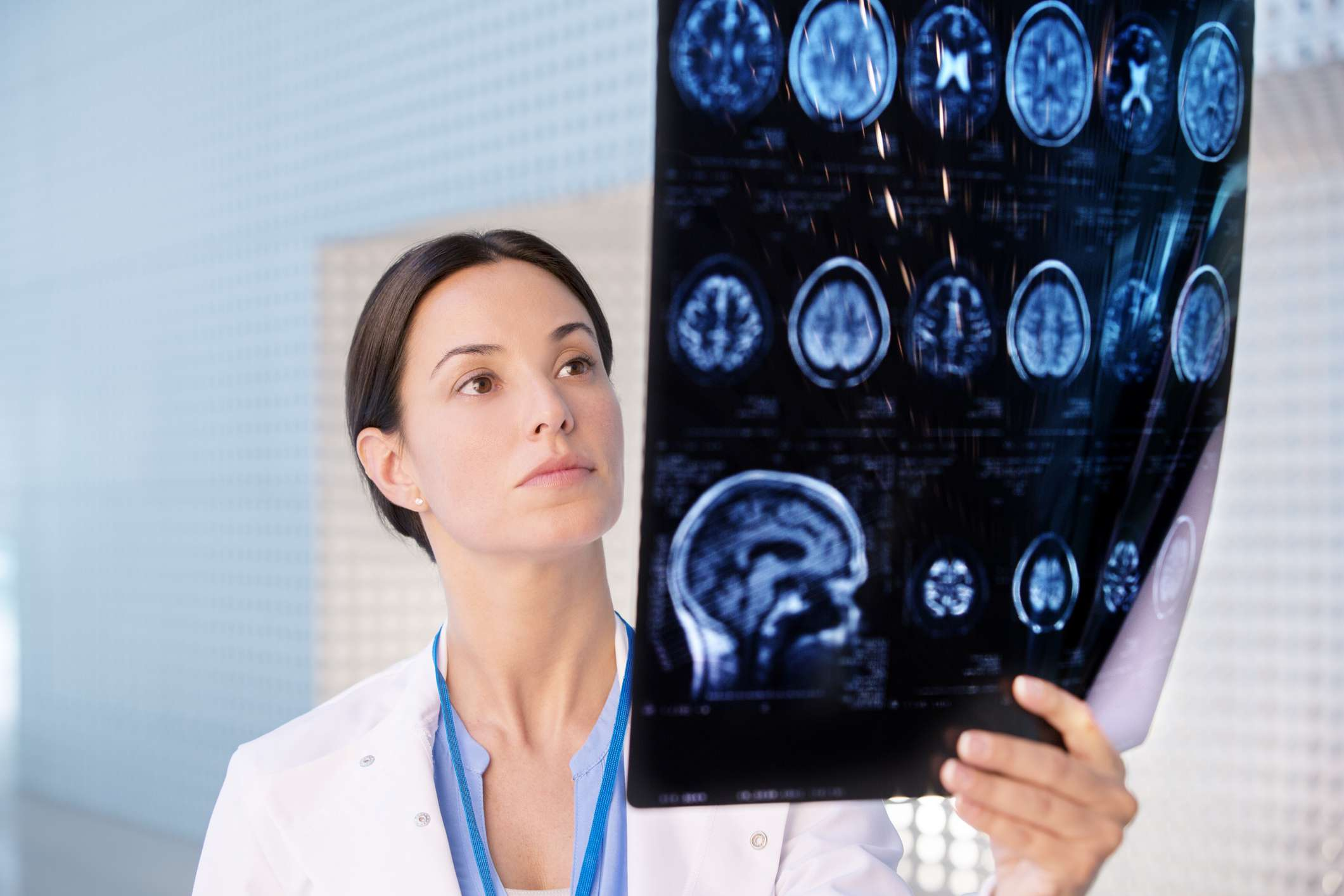 Doctor looking at CT scans of the brain