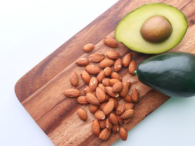 almonds and sliced avocado on cutting board