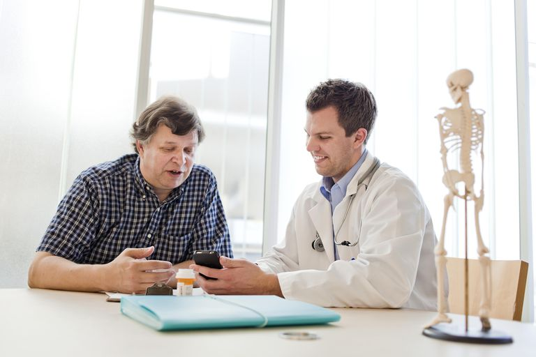A doctor and patient talking together