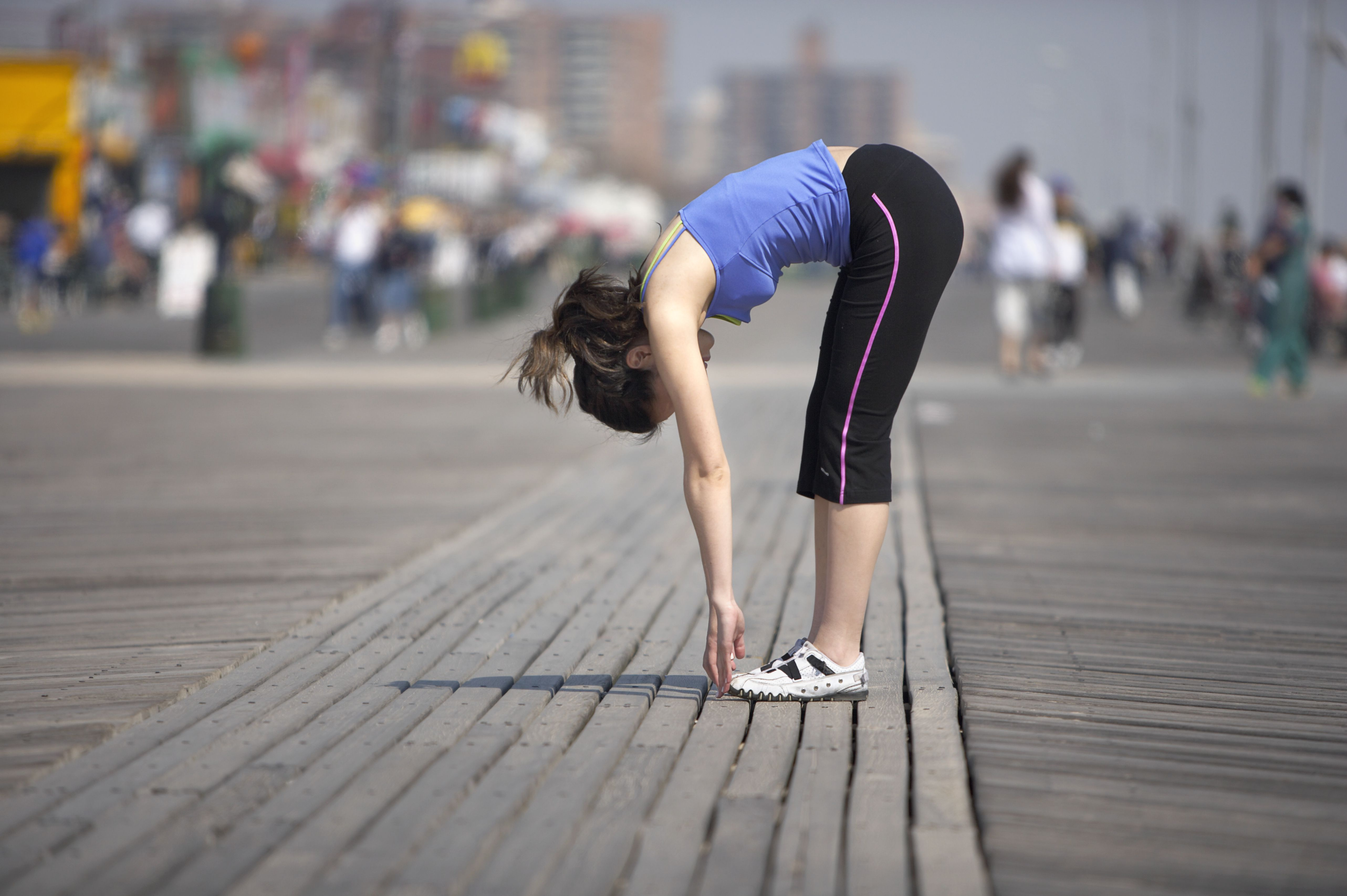 Jogger Touching Her Toes